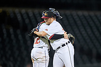 Mesa Solar Sox relief pitcher Will Vest (22) is congratulated by catcher Gavin Collins (12) after an Arizona Fall League game against the Peoria Javelinas on September 21, 2019 at Sloan Park in Mesa, Arizona. Mesa defeated Peoria 4-1. (Zachary Lucy/Four Seam Images)