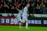Sunday 9th November 2014<br /> Pictured: Gylfi Sigurosson of Swansea City Celebrates with team mates<br /> Re: Barclays Premier League Swansea City v Arsenal at the Liberty Stadium, Swansea, Wales,UK
