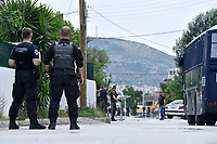 """Pictured: Police prsencel in Acharnes, Athens, Greece. Friday 09 June 2017<br /> Re: An 11 year old boy has been shot dead by a """"stray bullet"""" during a school celebration in Acharnes (Menidi) area, in the outskirts of Athens, Greece.<br /> Marios Dimitrios Souloukos """"complained to his mum"""" who works as a teacher at the 6th Primary School of Acharnes that he was feeling unwell, he then collapsed with blood pouring out from the top of his head.<br /> His mum tried to revive him assisted by other teachers while his schoolmates who were reportedly upset, were hurriedly removed by their parents.<br /> According to locals an ambulance arrived 25 minutes late.<br /> Hundreds of police officers have been deployed in the area and have raided many properties.<br /> Shells matching the fatal bullet which hit the boy on the top of his head were found in a house yard nearby.<br /> Local people reported hearing shots being fired at a nearby Romany Gypsy camp before the fatal incident.<br /> The area has been plagued with criminality during the last few years."""