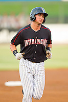 Michael Marjama (12) of the Kannapolis Intimidators rounds the bases after hitting a home run against the Lakewood BlueClaws at CMC-Northeast Stadium on August 14, 2013 in Kannapolis, North Carolina.  The Intimidators defeated the BlueClaws 10-2.  (Brian Westerholt/Four Seam Images)