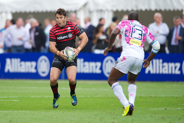 20120823 Copyright onEdition 2012©.Free for editorial use image, please credit: onEdition..Brad Barritt of Saracens looks to sidestep Vincent Mallet of Stade Francais Paris at The Honourable Artillery Company, London in the pre-season friendly between Saracens and Stade Francais Paris...For press contacts contact: Sam Feasey at brandRapport on M: +44 (0)7717 757114 E: SFeasey@brand-rapport.com..If you require a higher resolution image or you have any other onEdition photographic enquiries, please contact onEdition on 0845 900 2 900 or email info@onEdition.com.This image is copyright the onEdition 2012©..This image has been supplied by onEdition and must be credited onEdition. The author is asserting his full Moral rights in relation to the publication of this image. Rights for onward transmission of any image or file is not granted or implied. Changing or deleting Copyright information is illegal as specified in the Copyright, Design and Patents Act 1988. If you are in any way unsure of your right to publish this image please contact onEdition on 0845 900 2 900 or email info@onEdition.com