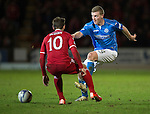 St Johnstone v Aberdeen...23.01.15   SPFL<br /> Brian Easton is closed down by Niall McGinn<br /> Picture by Graeme Hart.<br /> Copyright Perthshire Picture Agency<br /> Tel: 01738 623350  Mobile: 07990 594431