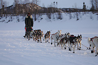 Ed Iten arrives at the ghost town of Iditarod,  the half-way checkpoint.  2005 Iditarod Trail Sled Dog Race.
