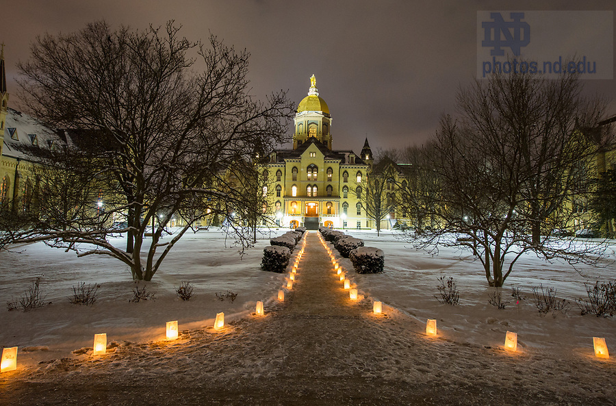 """January 15, 2018; Luminaries light Main Quad before a midnight prayer service in honor of the Rev. Martin Luther King Jr. holiday. The event also marked the beginning of """"Walk the Walk"""" week, a series of events and observances to celebrate and reflect on diversity and inclusiveness. (Photo by Barbara Johnston/University of Notre Dame)"""