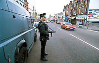 RUC officers on armed foot patrol performing a mobile vehicle checkpoint on the streets of Northern Ireland. They are stopping vehicles to check driving documents and to search for arms and explosives. This image may only be used to portray the subject in a positive manner..©shoutpictures.com..john@shoutpictures.com