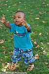15 month old toddler boy outside on grass language development pointing and talking vertical