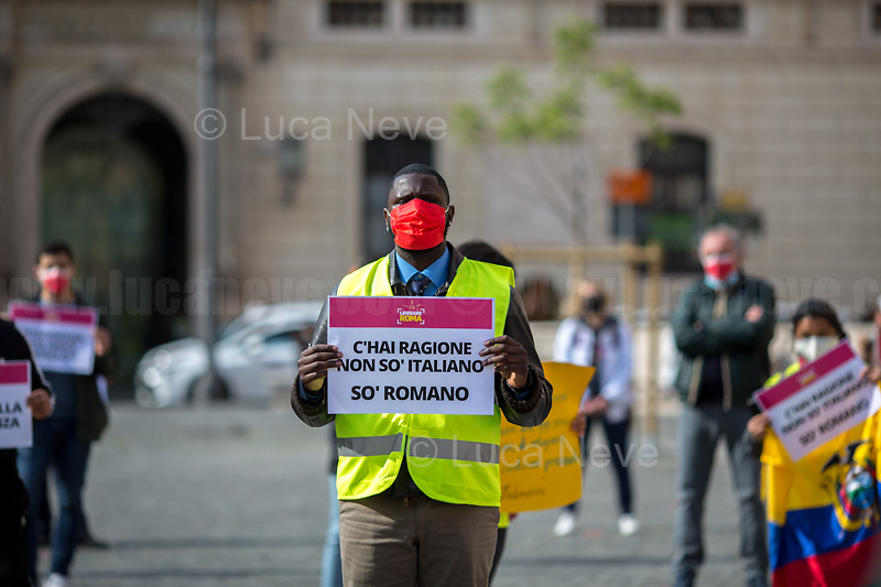 """Paolo Barros (Former 5 Star Movement Councillor of the IX Municipality of Rome).<br /> <br /> Rome, Italy. 21st Apr, 2021. Today, Liberare Roma and NiBi (Neri Italiani - Black Italians) held a flash-mob in Piazza San Silvestro (1.) to call the Italian Government led by Mario Draghi (Government supported by all the Italian Parties except the right wing Party Fratelli d'Italia) 2.) to finally make the long awaited reform of the citizenship law which will give the Italian Citizenship to the children who are born and grown up in Italy once called """"Ius Soli"""" or """"Ius Culturae"""" Law. <br /> «I was born here in Italy, I grew up here, I live here, I study here, I love here, I live and plan my future here. However, I do not have the same rights of all the other Italians» (1.).<br /> <br /> Footnotes and Links:<br /> 1. http://bit.do/fQy7U <br /> 2. http://bit.do/fQy9F  <br /> Previous Demos: <br /> - First Conte's Government (Centre-Right) http://bit.do/fi83r <br /> - Second Conte's Government (Centre-Left) http://bit.do/fJ2pc<br /> - Second Conte's Government (Centre-Left) http://bit.do/fQy9F"""