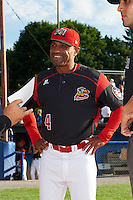 Batavia Muckdogs manager Angel Espada (4) during the lineup exchange before a game against the State College Spikes on June 22, 2016 at Dwyer Stadium in Batavia, New York.  State College defeated Batavia 11-1.  (Mike Janes/Four Seam Images)