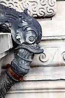 Near Saint Germain, an ancient water pipe connection in the form of a metal fish with open mouth (Paris, 2010).<br /> <br /> Vicino Saint Germain, un'antica connessione di tubature nella forma di un pesce di metallo con la bocca aperta (Parigi, 2010).