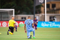 LAKE BUENA VISTA, FL - JULY 14: Alexander Callens #6 of NYCFC kneeling before the game during a game between Orlando City SC and New York City FC at Wide World of Sports on July 14, 2020 in Lake Buena Vista, Florida.