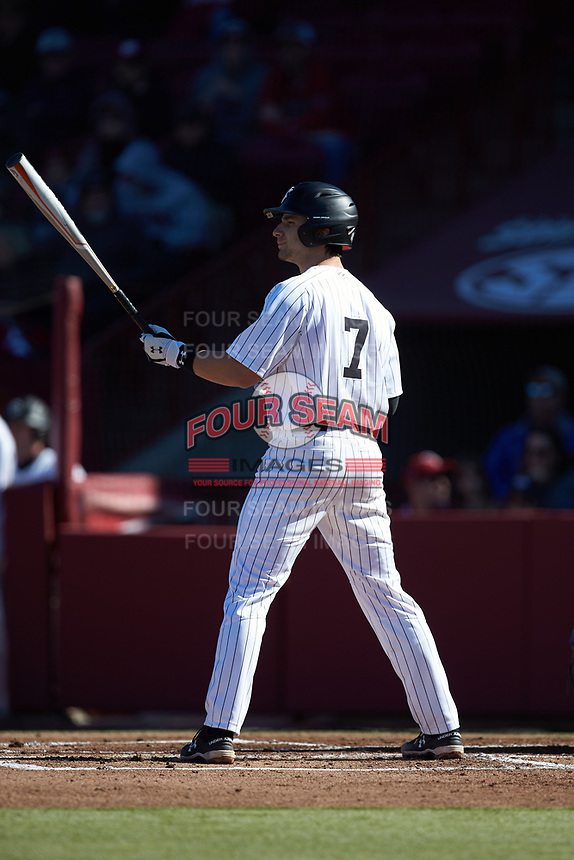 Brennan Milone (7) of the South Carolina Gamecocks at bat against the Holy Cross Crusaders at Founders Park on February 15, 2020 in Columbia, South Carolina. The Gamecocks defeated the Crusaders 9-4.  (Brian Westerholt/Four Seam Images)