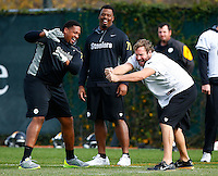 Ben Roethlisberger #7 and Ramon Foster #73 of the Pittsburgh Steelers practice at the south side practice facility on November 18, 2015 in Pittsburgh, PA.