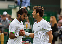 01-07-13, England, London,  AELTC, Wimbledon, Tennis, Wimbledon 2013, Day seven, Jean-Julien Rojer (NED) (R)and his doubles partner Aisam Qureshi (PAK)<br /> <br /> <br /> <br /> Photo: Henk Koster