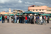 Marrakesh, Morocco.  Men Gathered around a Storyteller in the Place Jemaa El Fna.
