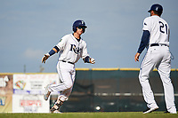 Princeton Rays catcher Roberto Alvarez (13) is congratulated by coach Rafael Valenzuela (21) as he rounds third base after hitting a home run in the bottom of the second inning during the first game of a doubleheader against the Johnson City Cardinals on August 17, 2018 at Hunnicutt Field in Princeton, Virginia.  Johnson City defeated Princeton 6-4.  (Mike Janes/Four Seam Images)