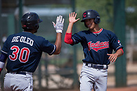 Cleveland Indians shortstop Tyler Freeman (7) high fives Henderson De Oleo (30) after scoring a run during an Extended Spring Training game against the Arizona Diamondbacks at the Cleveland Indians Training Complex on May 27, 2018 in Goodyear, Arizona. (Zachary Lucy/Four Seam Images)