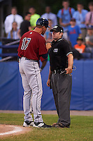 Umpire Donnie Smith listens to Mahoning Valley Scrappers manager Travis Fryman (17) argue a call after ejecting him during a game against the Batavia Muckdogs on June 24, 2015 at Dwyer Stadium in Batavia, New York.  Batavia defeated Mahoning Valley 1-0 as three Muckdogs pitchers combined to throw a perfect game.  (Mike Janes/Four Seam Images)