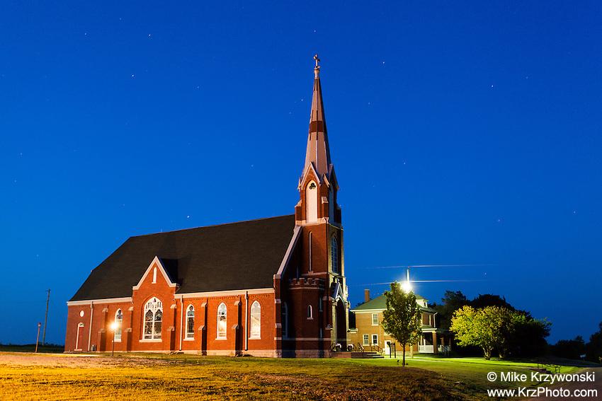 St. Columbkille Catholic Church at night in Blaine, KS