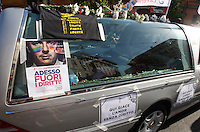 """Un momento del Gay Pride a Roma, 7 giugno 2014.<br /> A hearse carrying the of a skeleton, with signs at bottom, reading """"Here lies love without right"""" makes his way during the Gay Pride in Rome, 7 June 2014. The sign at left, with a picture of Italian Premier Matteo Renzi, reads """"Now get rights out!""""<br /> UPDATE IMAGES PRESS/Riccardo De Luca"""