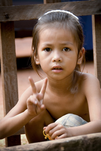 A young girl in rural village outside of Siem Reap, Cambodia. The Khmer Rouge Regime led by Pol Pot took over Cambodia from 1975-1979 which subjected Cambodia to a radical social reform process.