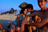 Irina Chil del Risco is charmed by the affections of Manuel E. Risco while their friend is odd man out during a weekend outing on a beach east of Havana