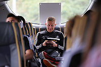 Wednesday 28 August 2013<br /> Pictured: Garry Monk on the team bus en route to Cardiff Airport.<br /> Re: Swansea City FC players and staff en route for their UEFA Europa League, play off round, 2nd leg, against Petrolul Ploiesti in Romania.