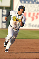 Burlington Bees Michael Hermosillo (4) runs to third base during the Midwest League game against the Peoria Chiefs at Community Field on June 9, 2016 in Burlington, Iowa.  Peoria won 6-4.  (Dennis Hubbard/Four Seam Images)