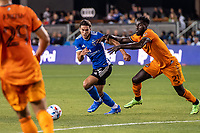 SAN JOSE, CA - JULY 24: Cade Cowell #44 of the San Jose Earthquakes  dribbles the ball past Derrick Jones #21 of the Houston Dynamo during a game between San Jose Earthquakes and Houston Dynamo at PayPal Park on July 24, 2021 in San Jose, California.