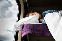 A young girl sleeps on the Xining to Lhasa train, a 24-hour journey that takes passengers across highland grasslands and through mountain passes into Tibet. It's regarded as one of the most interesting and visually spectacular train journeys in all of China.