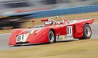 A vintage race car races through a corner during an historick racing event at Daytona International Speedway, Daytona Beach, FL.  (Photo by Brian Cleary/www.bcpix.com)