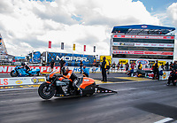 Aug 9, 2020; Clermont, Indiana, USA; NHRA pro stock motorcycle rider Angelle Sampey (near) alongside Chris Bostick in the final round of the Indy Nationals at Lucas Oil Raceway. Mandatory Credit: Mark J. Rebilas-USA TODAY Sports