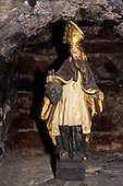 Slovakia: wine cellar; statue of Saint Urban of Langres the patron Saint of grapes wearing a mitre and holding a bunch of grapes.