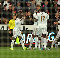 Pictured L-R: Nathan Dyer celebrates his goal with Kyle Bartley and Eder of Swansea Tuesday 25 August 2015<br /> Re: Capital One Cup, Round Two, Swansea City v York City at the Liberty Stadium, Swansea, UK.