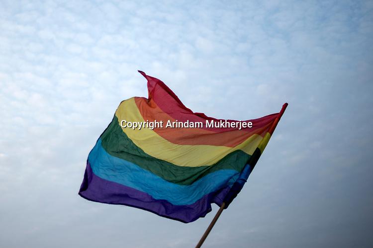 LGBT flag flies during a rally in Kolkata, West Bengal, India. Arindam Mukherjee