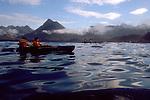 Alaska, Sea kayakers off Chichagof Island at dawn. West Chichagof-Yakobi Wilderness Area, Southeast Alaska, Pt Urey,.