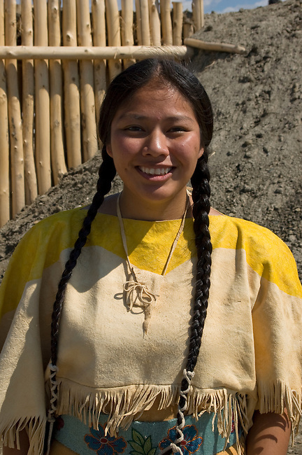 Young woman dressed in traditional ladies dress of the Mandan Indians guides visitors through the Mandan/Hidatsa/Arikara village of earth dwellings on the Fort Berthold Indian Reservation, ND