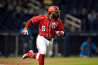 Washington Nationals Josh Harrison (5) runs to first base during a Major League Spring Training game against the Miami Marlins on March 20, 2021 at FITTEAM Ballpark of the Palm Beaches in Palm Beach, Florida.  (Mike Janes/Four Seam Images)