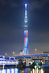 Tokyo Skytree tower is lit up in rainbow color to commemorate Japanese girl group NiziU's official debut in Tokyo, Japan on December 3, 2020. (Photo by Naoki Nishimura/AFLO)