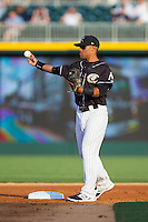 Charlotte Knights second baseman Micah Johnson (3) throws the ball around between innings of the game against the Scranton/Wilkes-Barre RailRiders at BB&T Ballpark on July 17, 2014 in Charlotte, North Carolina.  The Knights defeated the RailRiders 9-5.  (Brian Westerholt/Four Seam Images)
