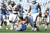 CHAPEL HILL, NC - NOVEMBER 14: Dion Bergan Jr. #95 of Wake Forest sacks Sam Howell #7 of North Carolina for a loss during a game between Wake Forest and North Carolina at Kenan Memorial Stadium on November 14, 2020 in Chapel Hill, North Carolina.