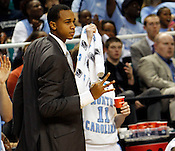 John Henson celebrates a 3-pointer in the second haf. UNC defeated Vermont 77-58 during the 2nd round of the 2012 NCAA Basketball Championship at the Greensboro Coliseum in Greensboro, NC. Photo by Al Drago.