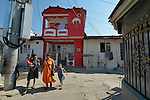 Roma women and children walk down a street in Suto Orizari, Macedonia. The mostly Roma community, located just outside Skopje, is Europe's largest Roma settlement. .