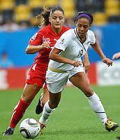 USA's Sydney Leroux (R) and Jehona Mehmeti of Switzerland during the FIFA U20 Women's World Cup at the Rudolf Harbig Stadium in Dresden, Germany on July 17th, 2010.