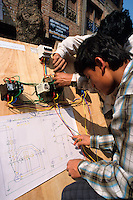 "NEPAL Kathmandu, SKILL project, vocational training as electrician for young students, Implemented by NGO ""SKILL-Nepal"" The SKILL project initiated  a new modality of training: mobile trainers go to rural areas to implement training courses at the local level; training is need based and on the demand from the local village or a local organization; participants get practical skills / NEPAL Kathmandu, Skill Projekt, Berufsausbildung fuer Jugendliche, Elektriker Kurs"