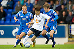 St Johnstone v Bolton....02.08.10  Pre-Season Friendly.Chung Yong Lee is tracked by Murray Davidson and Danny Grainger.Picture by Graeme Hart..Copyright Perthshire Picture Agency.Tel: 01738 623350  Mobile: 07990 594431