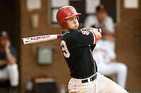 Robert Case #29 of the St. John's Red Storm follows through on his swing against the Virginia Cavaliers in the championship game of the Charlottesville Regional at Davenport Field on June 7, 2010, in Charlottesville, Virginia.  The Cavaliers defeated the Red Storm 5-3.  Photo by Brian Westerholt / Four Seam Images