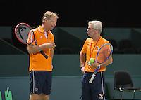 Swiss, Genève, September 14, 2015, Tennis,   Davis Cup, Swiss-Netherlands, practise Dutch team,  coach Martin Bohm listen to captain Jan Siemerink (L)<br /> Photo: Tennisimages/Henk Koster