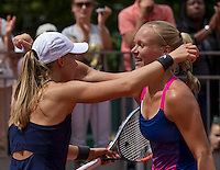 Paris, France, 22 June, 2016, Tennis, Roland Garros, womans doubles: Kiki Bertens (NED) and her partner Johanna Larsson (SWE) (L)<br /> Photo: Henk Koster/tennisimages.com