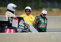 Mar. 10, 2012; Gainesville, FL, USA; NHRA funny car driver John Force (right) checks out the damage after daughter Courtney Force (not pictured) hit the wall during qualifying for the Gatornationals at Auto Plus Raceway at Gainesville. Mandatory Credit: Mark J. Rebilas-