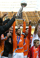Houston captain Wade Barrett looks up at the trophy at games end. The Houston Dynamo defeated the New England Revolution 2-1 in the finals of the MLS Cup at RFK Memorial Stadium in Washington, D. C., on November 18, 2007.